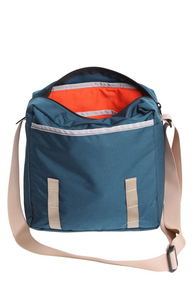 view of open bag to show inside contrasting colored material.