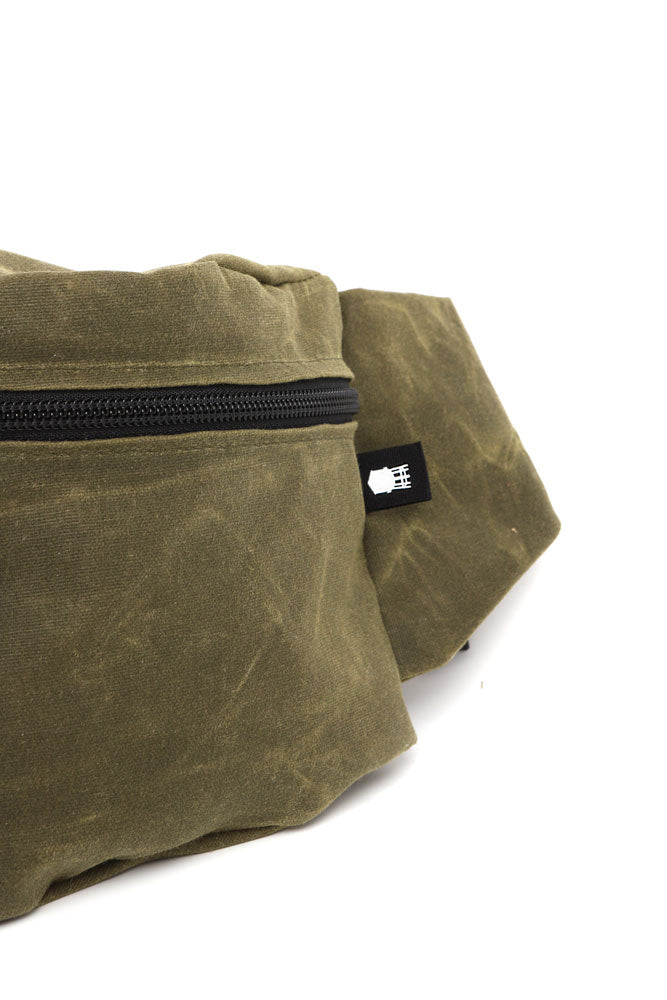 detail of water tower on ZEKI WAIST PACK IN OLIVE WAX CANVAS