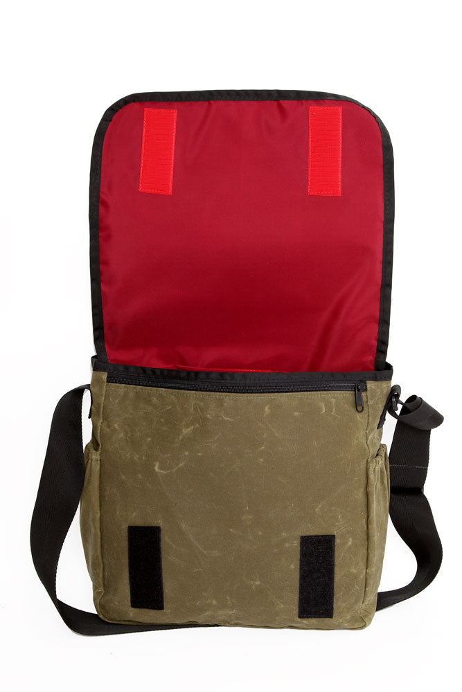 COURIER STYLE MESSENGER BAG OPEN WITH TOP BACK SHOWING RED LINER OF OLIVE WAX BAG