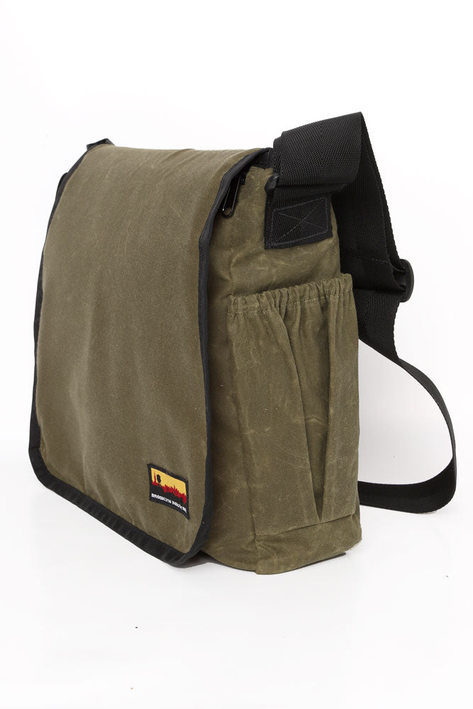 SIDE VIEW OF COURIER STYLE MESSENGER BAG IN OLIVE WAX