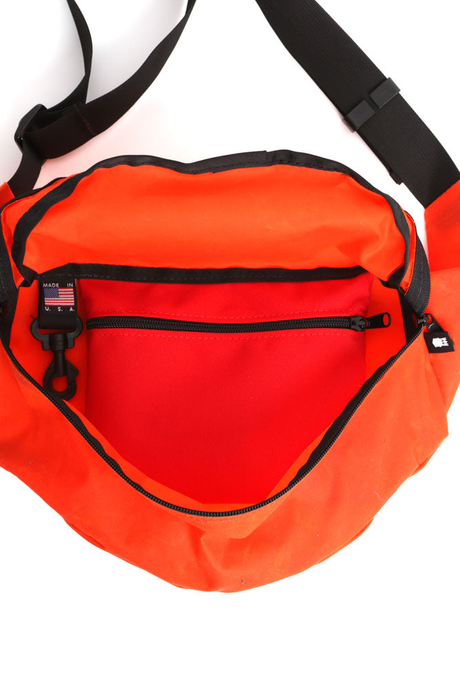 INSIDE VIEW OF ORANGE WAXED CANVAS FANNY PACK