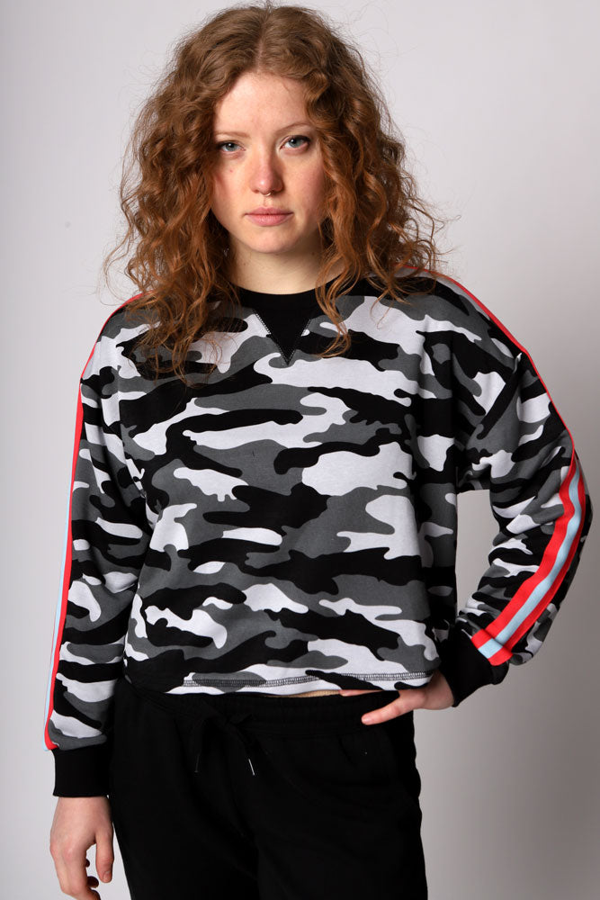 Cozy cropped gray scale camo printed pullover sweatshirt in a soft sueded French terry knit with red and blue racing stripe down the sleeves.
