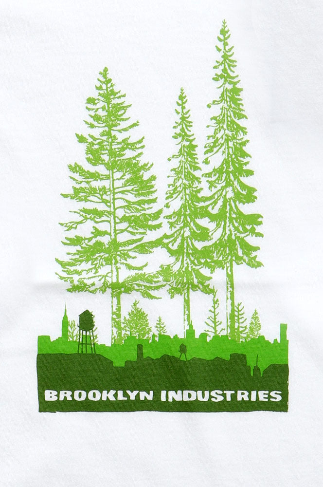 THREE BRIGHT GREEN TREES GROWN OUT OF A DARKER GREEN CITY SKYLINE WITH WATER TOWER, OVERGROWN CITY GRAPHIC