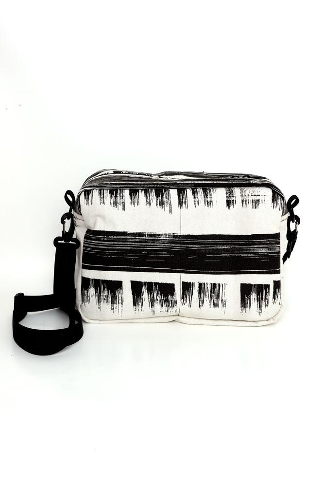 BACK VIEW OF CROSS BODY BAG IN BLACK AND WHITE BRUSHED INK PATTERNED CANVAS