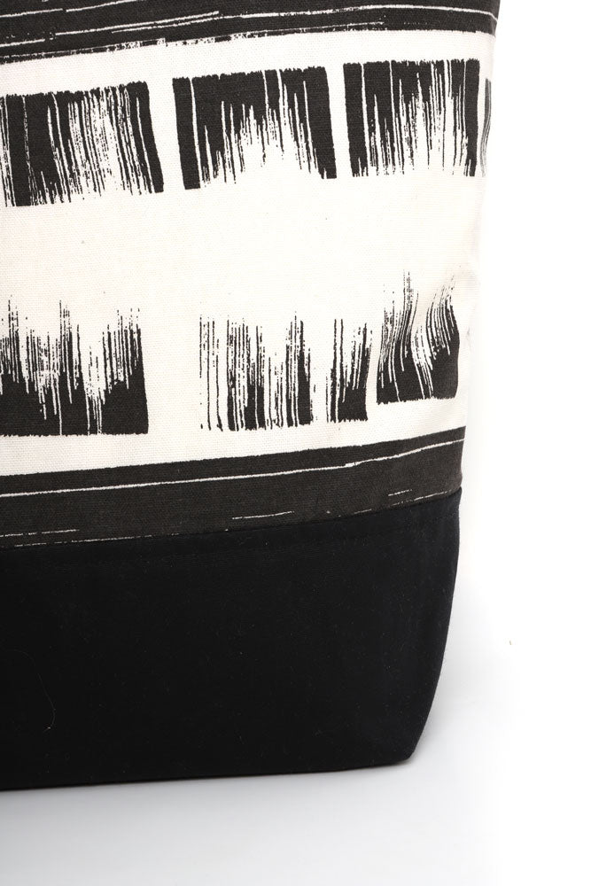 Detail of the brushed ink fabric and black waxed canvas bottom