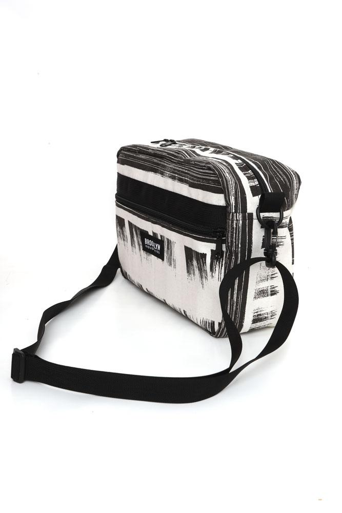 SIDE VIEW OF CROSS BODY BAG IN BLACK AND WHITE BRUSHED INK PATTERNED CANVAS