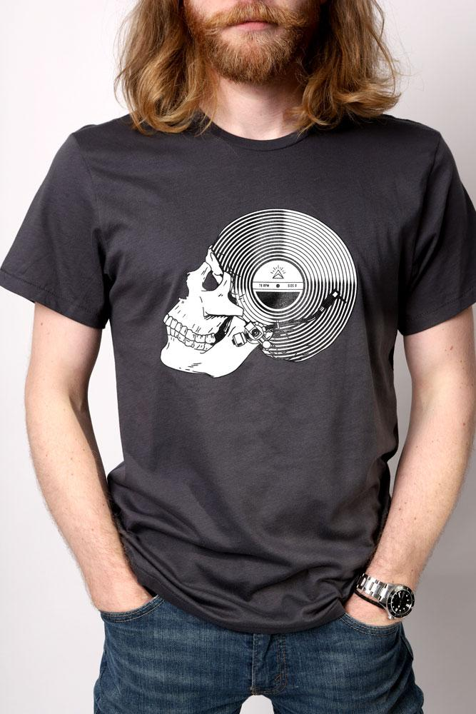 man with long red hair wears record skull t-shirt