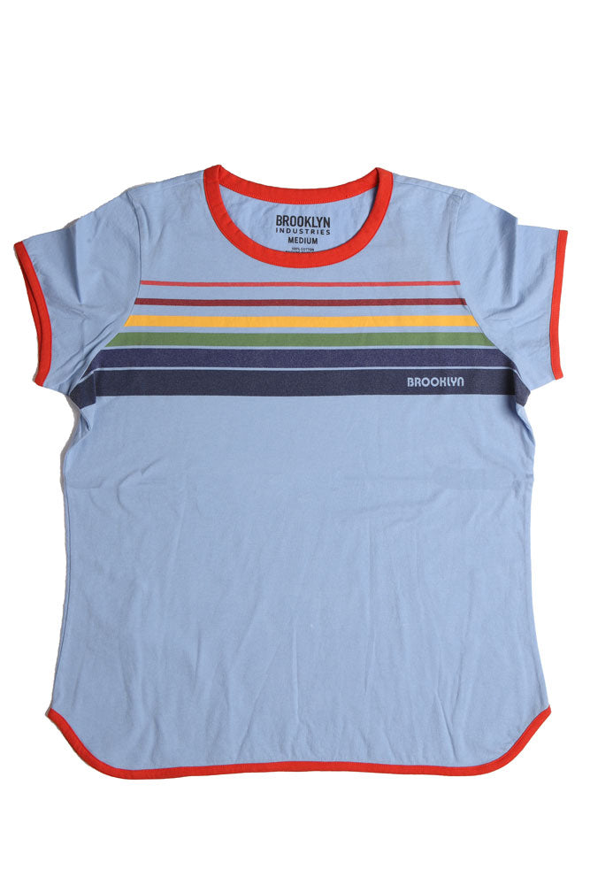 Flat lay, blue t-shirt with white rim detail, and retro rainbow detail across the chest, with brooklyn writtin on the bottom color.
