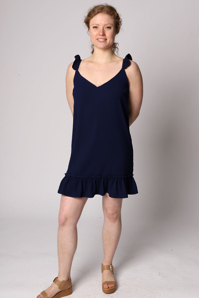 The Shifted & Talented is a sleeveless crepe shift dress ruffle trimmed straps and hem detail