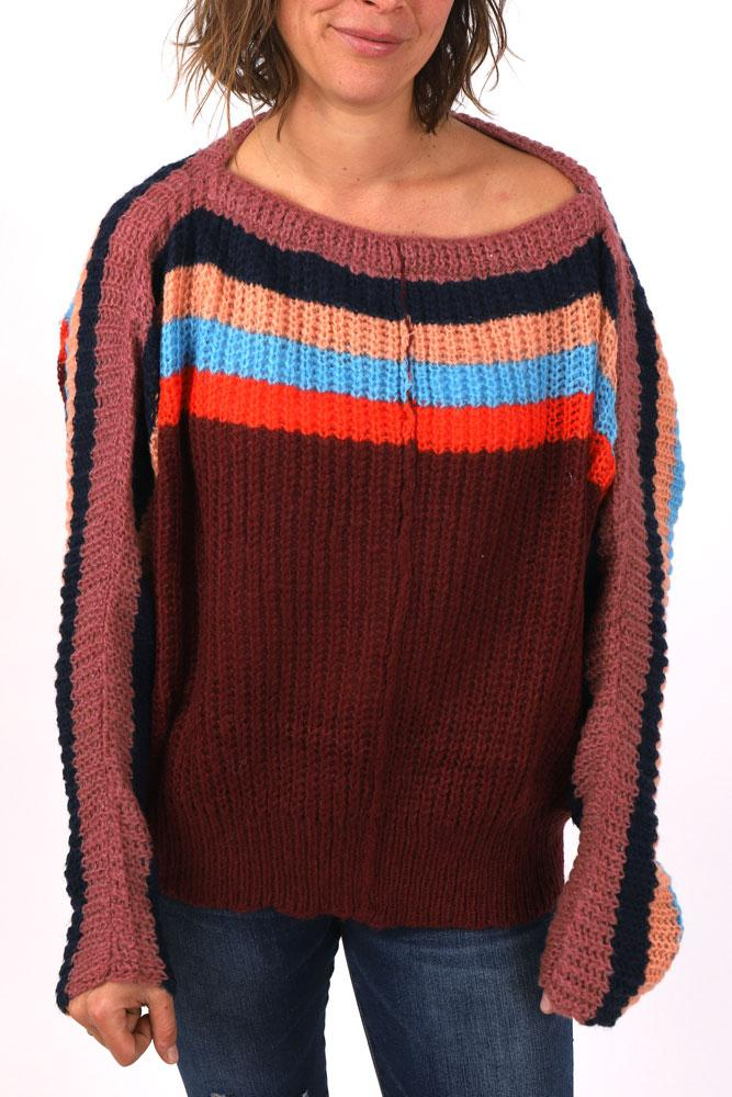women wears maroon bodied chunky sweater with red, blue orange and light pink stripes