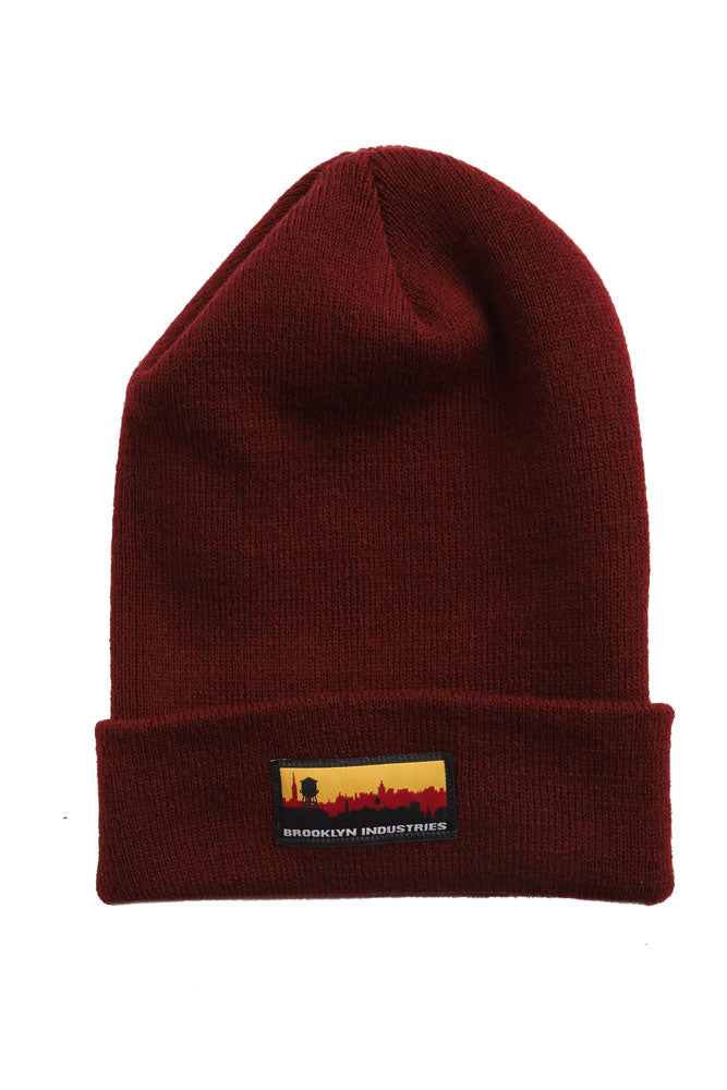 FLAT LAY OF SKYLINE BEANIE IN MAROON