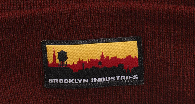 DETAIL OF SKYLINE PATCH ON BEANIE IN MAROON