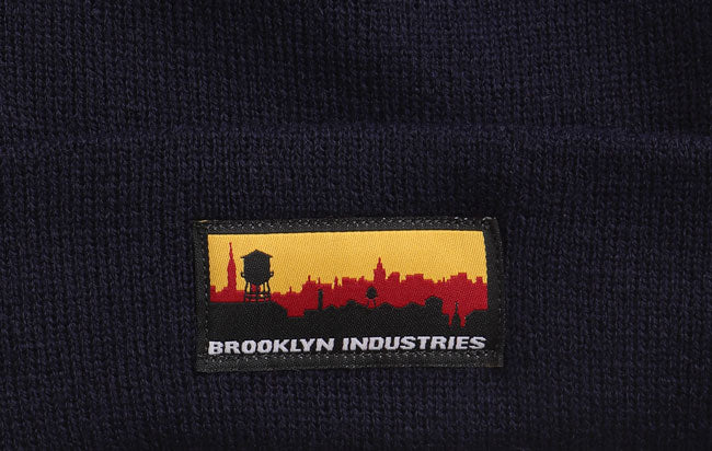 DETAIL OF SKYLINE PATCH ON BEANIE IN NAVY