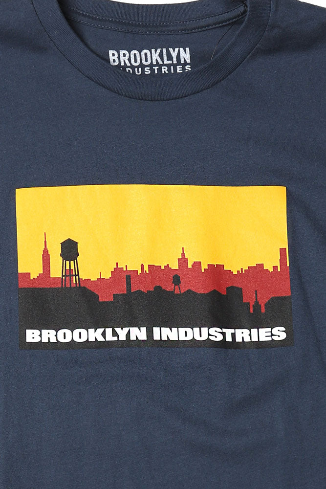 Our founder Vahap Avsar designed this logo from the factory rooftop in 1996.  From the corner of North 9th Street and Wythe Ave, the view looked North over Queens to Manhattan.  He choose industrial colors- burgundy, orange, black- bold choices.
