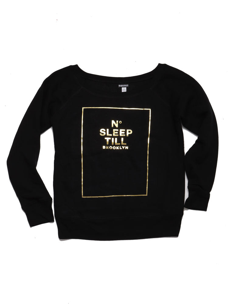 FLAT LAY OF SLEEP NUMBER NO SLEEP TIL BROOKLYN SWEATSHIRT IN BLACK WITH FOLD LETTERING