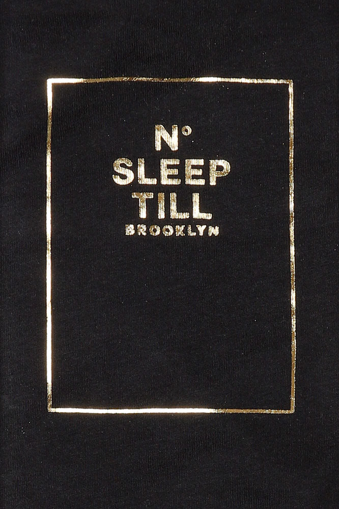 DETAIL OF NO SLEEP GRAPHIC ON BLACK T-SHIRT