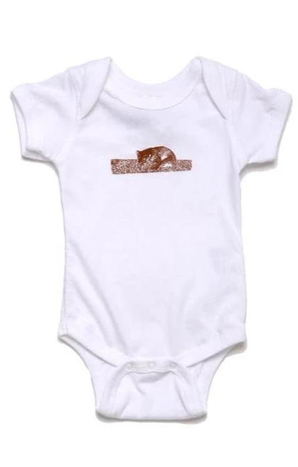 white onesie for babies with brown graphic on a bear on  a log