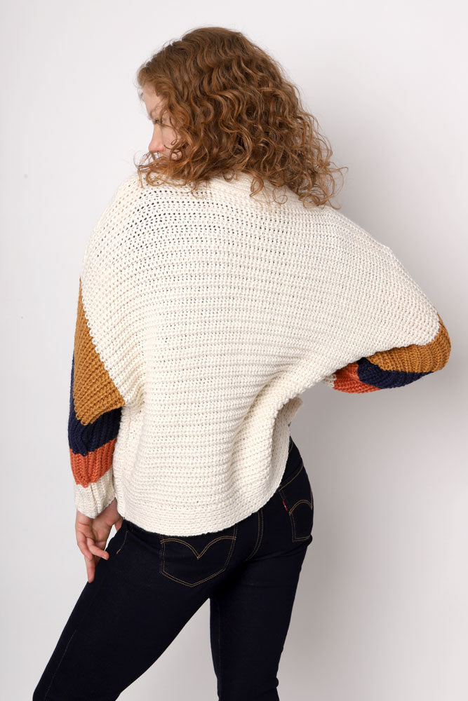 back view of open front ivory rib knit sweater