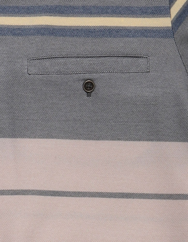 detail of the pocket on men's stripe knit shirt in muted greens and yellow