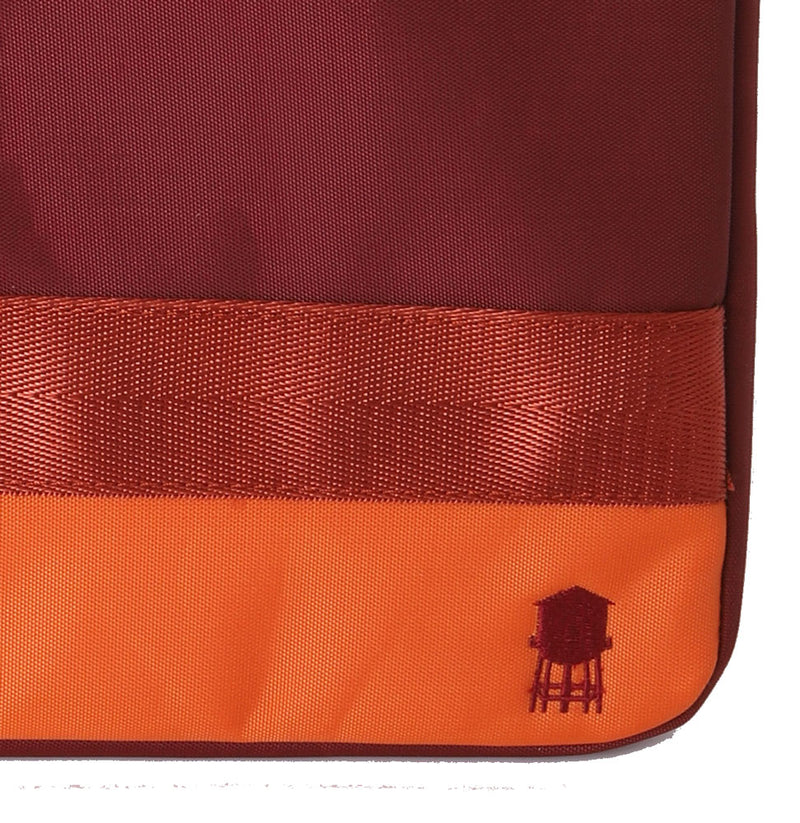 SMALL LINED TECH BAG IN REDS AND ORANGE DETAIL OF EMBROIDERED RED WATER TOWER