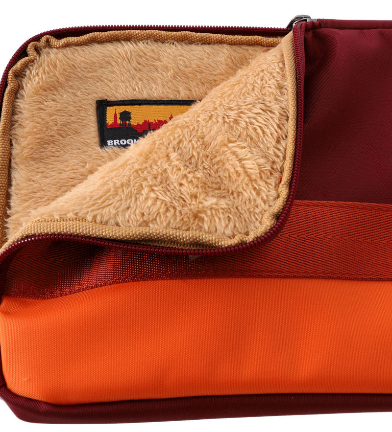 SMALL LINED TECH BAG IN REDS AND ORANGE, DETAIL OF LINING AND BKI LABEL