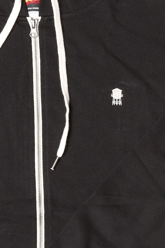 DETAIL OF  FRENCH TERRY ZIP UP, BLACK SWEATSHIRT,  WHITE TOWER EMBROIDERY