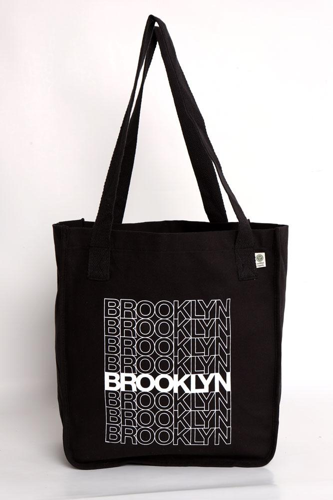 ORGANIC COTTON TOTE BAG WITH BROOKLYN TEXT DOWN THE FRONT LIKE A CLASSIC BODEGA BAG - BLACK WITH WHITE GRAPHIC