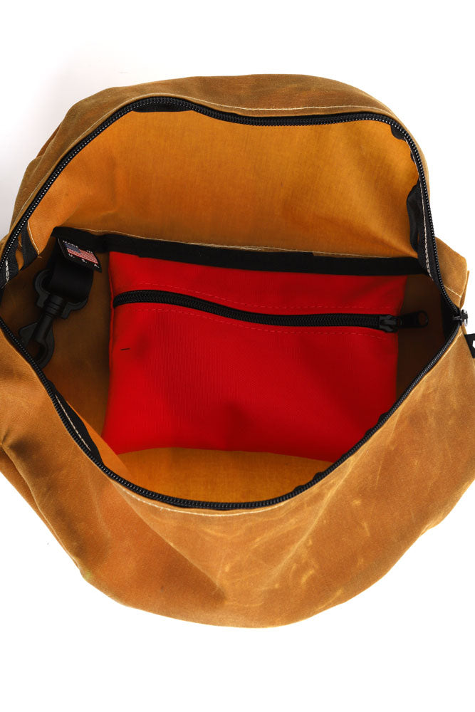 INSIDE VIEW OF ZEKI WAISTPACK IN TOAST WAX CANVAS SHOWING RED POCKET AND KEY CLIP