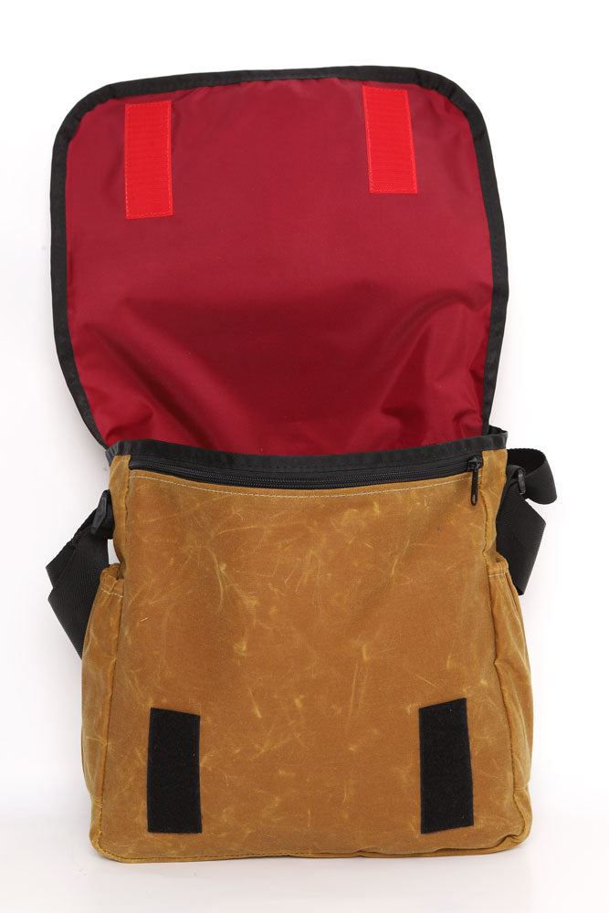 COURIER STYLE MESSENGER BAG OPEN WITH TOP BACK SHOWING RED LINER OF  TOAST WAX BAG