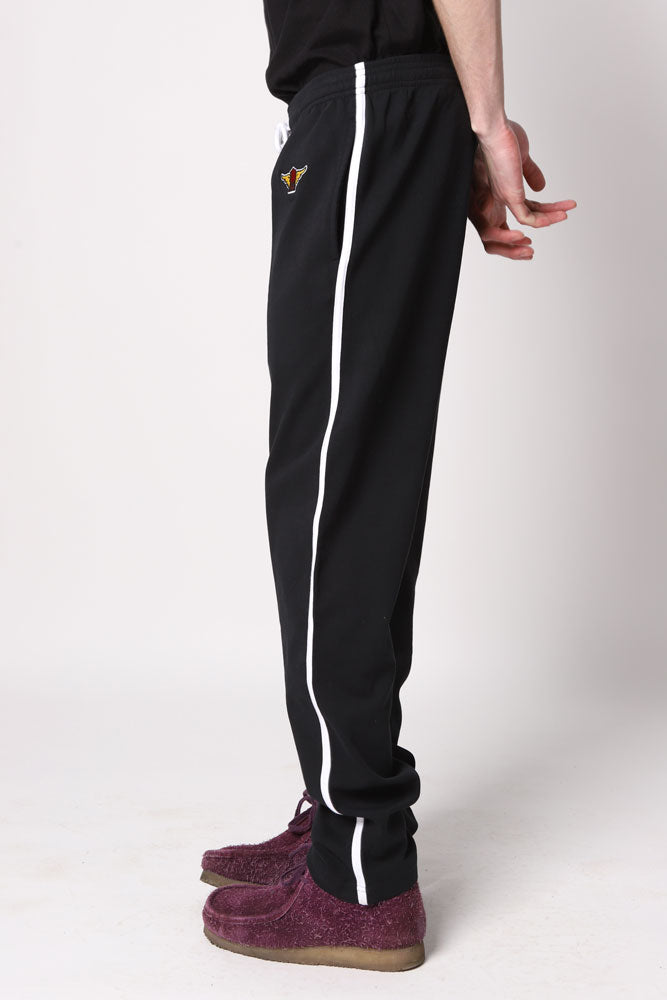BLACK TRACK PANT WITH WINGED WATER TOWER EMBROIDERY ON THE HIP< AND WHILE PIPING DOWN THE SIDE