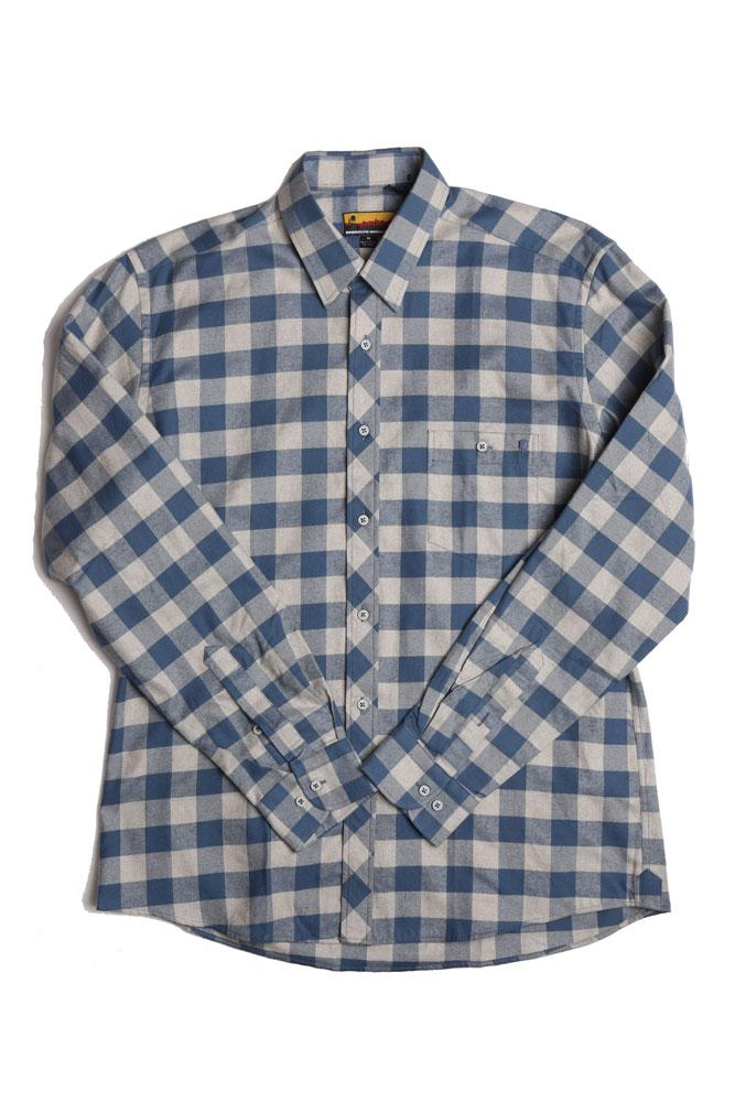 flat lay of blue and tan  check plaid flannel shirt with sleeves crossed to center
