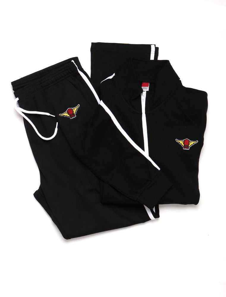 flat lay of water tower wing track jacket and pant