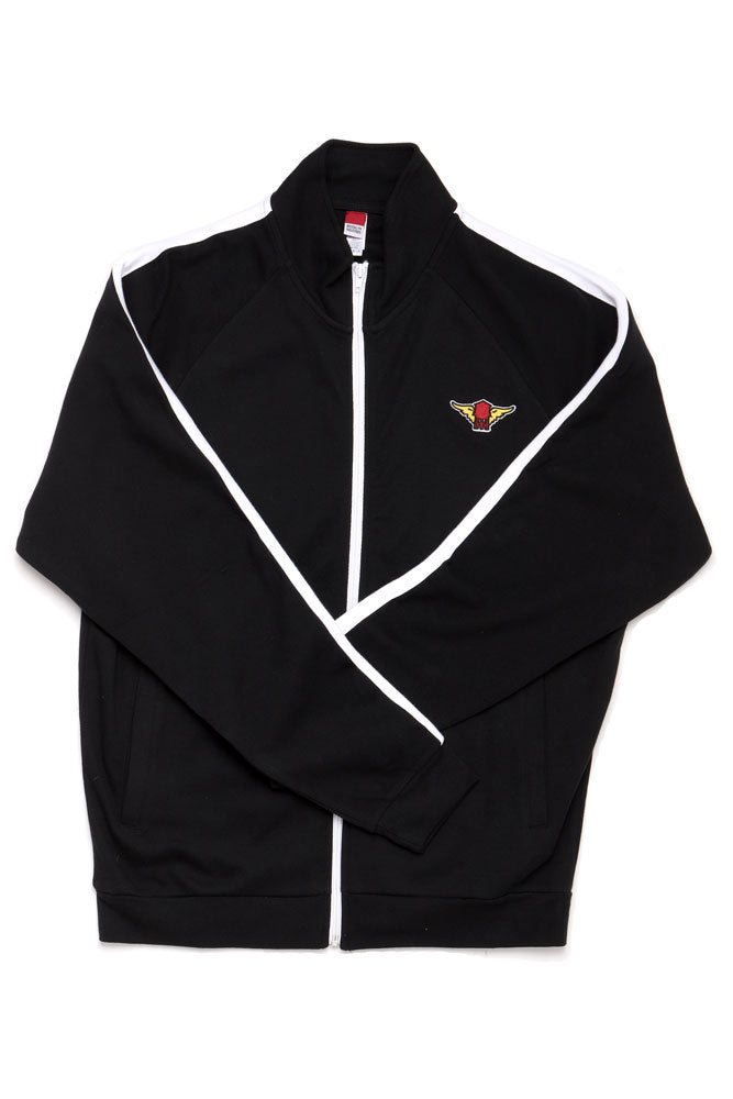 black track jacket flat lay with with winged water tower patch on left chest arms crossed