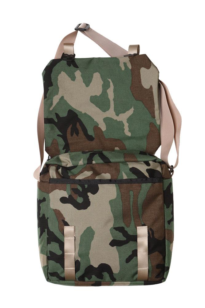 flat image of the woodland camo mail bag flat lay, with the top flipped open to reveal the front slide pocket and the large zip pocket