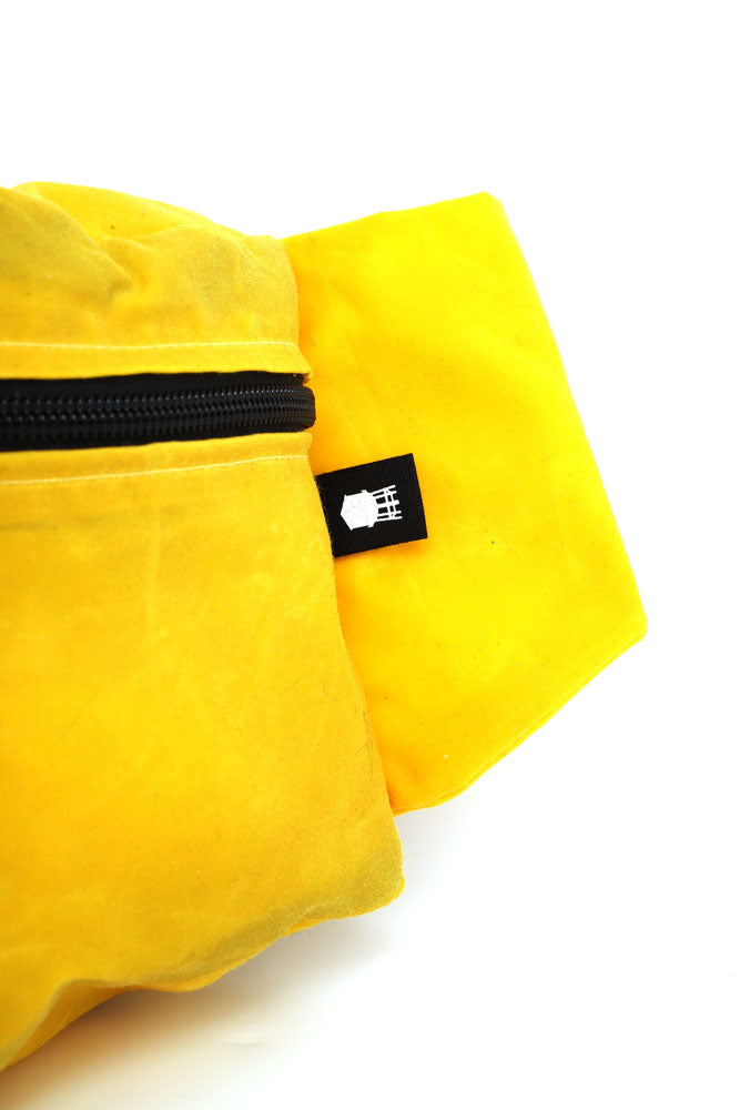 detail of water tower tag on yellow Zeki waistpack