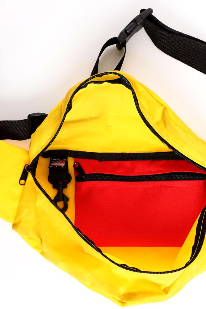 Inside view of the  yellow waxed zeki showing the red pocket and key hang