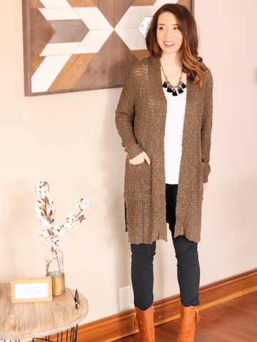 The Brynn Cardigan is a slouchy, cable knit long cardigan with pockets! Available in S-3XL. Photo Cred: Just Gorgeous Darling Boutique