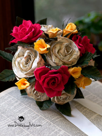 bouquet with red and yellow roses and beauty and the beast story on a book