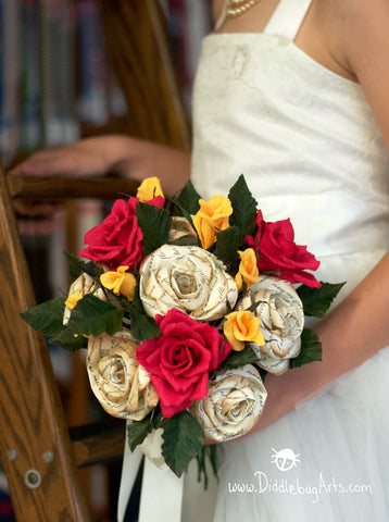 Bouquet with red roses, yellow rose buds and French version of Beauty and the Beast roses