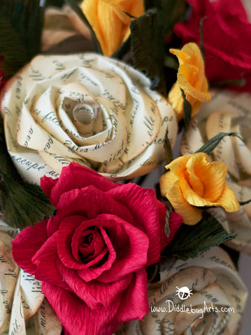close up of paper red rose, yellow buds and story roses