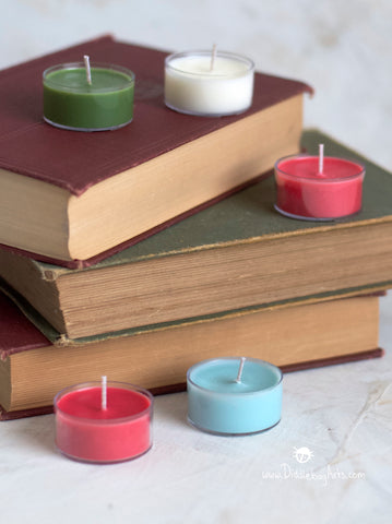 tea light candles arranged on old books