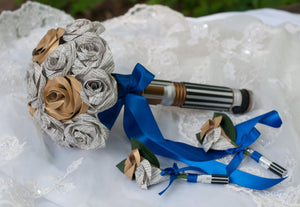light saber handled bridal bouquet with light saber star wars boutonniere with book page roses
