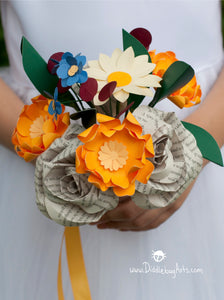 Medium sized paper book page and oranges and reds and blues bridesmaid bouquet