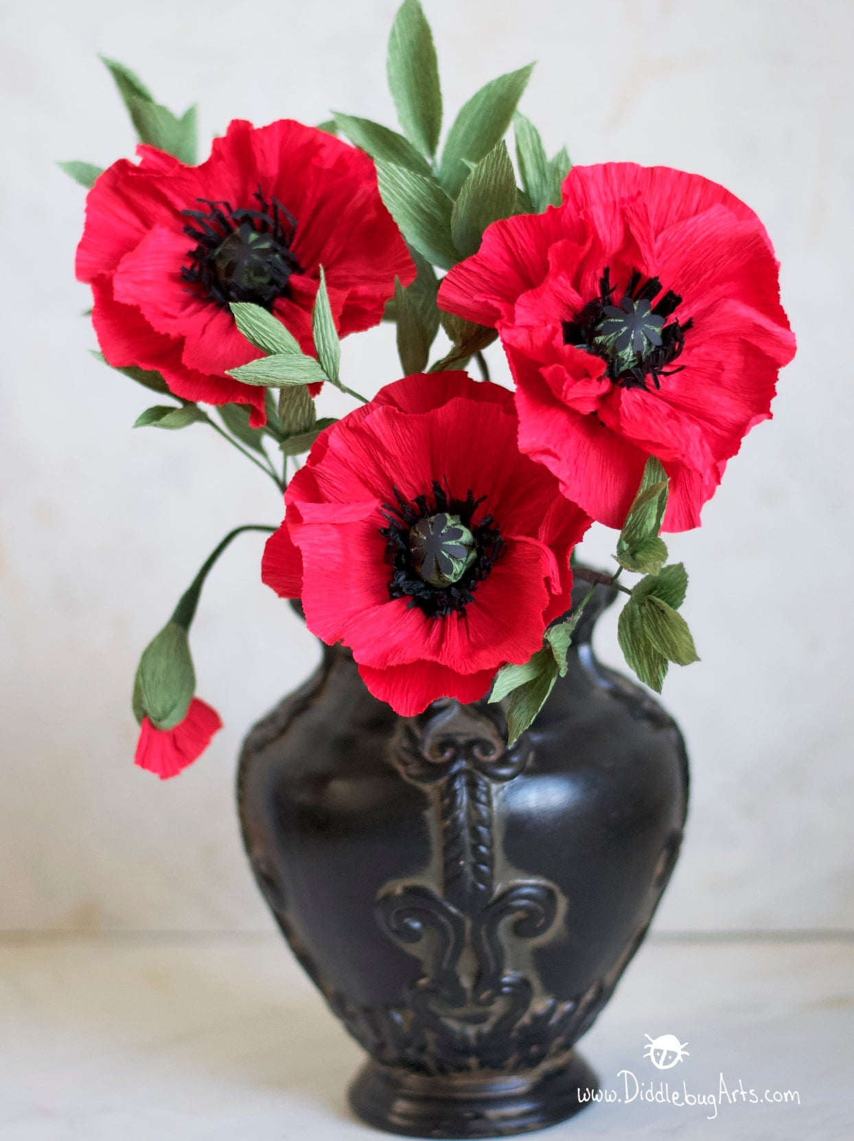 red crepe paper poppies in a vase