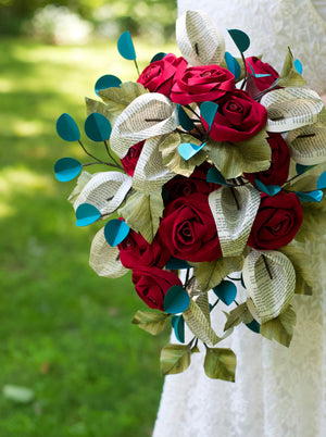 bridal bouquet made of paper with roses and calla lilies made from book pages