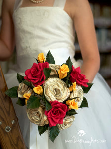 Beauty and the Beast inspired paper rose Bouquet being held by a bride in a library