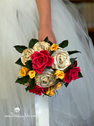 bride holding a paper rose beauty and the beast inspired wedding bouquet