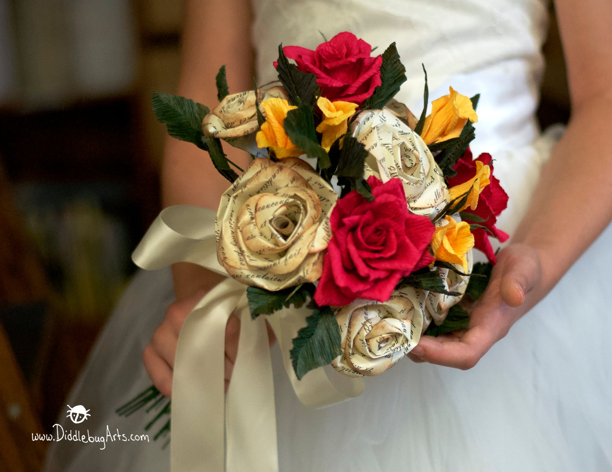 Beauty and the Beast wedding bouquet paper roses being held in a library