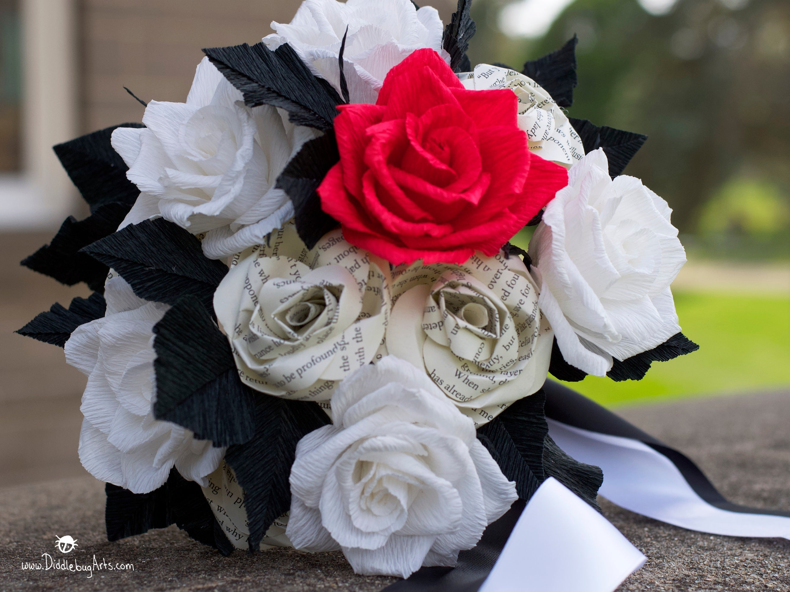 black white and red roses and book page rose bouquet