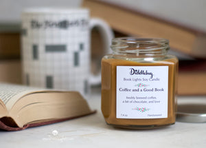 soy candle with coffee scent pictured with a book and coffee